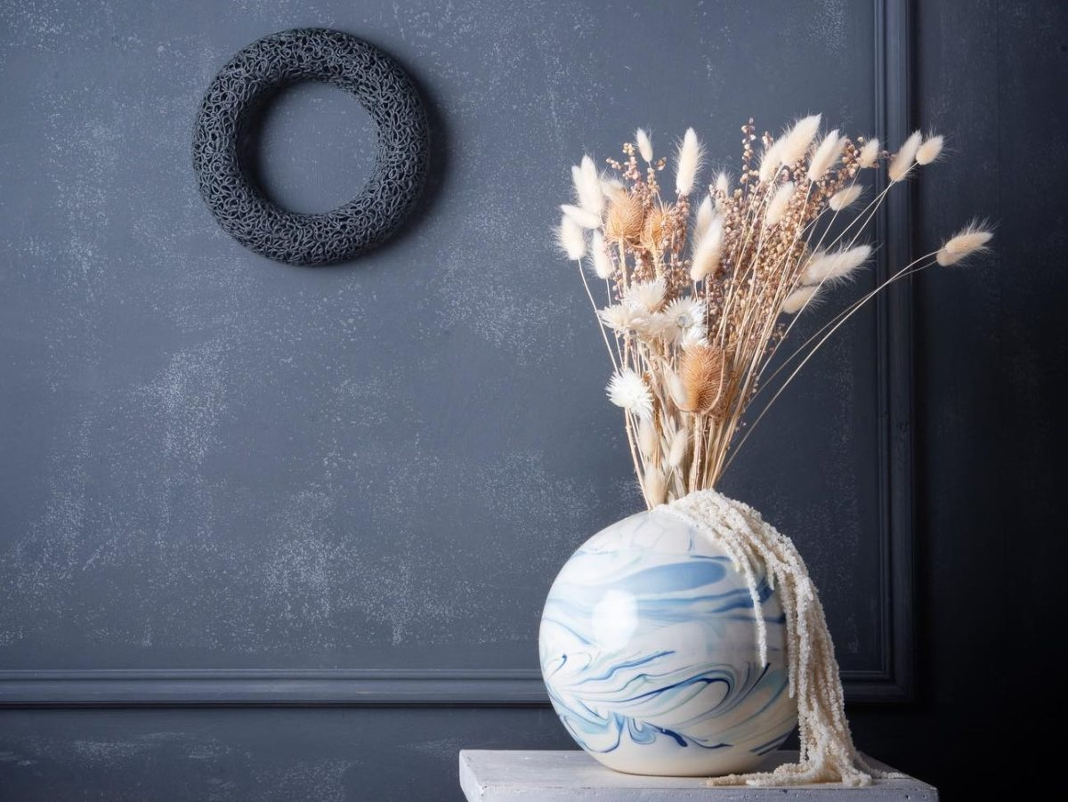 marbled ceramic vase and piped ceramic wall sculpture