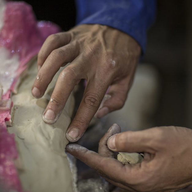 Cape Town, South Africa, man working in sculpting studio, working with mold