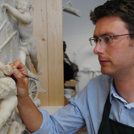 Felix Thornton-Jones working on a marble relief (sculptor - John Deare 1796) that is now in the collections of the V&A