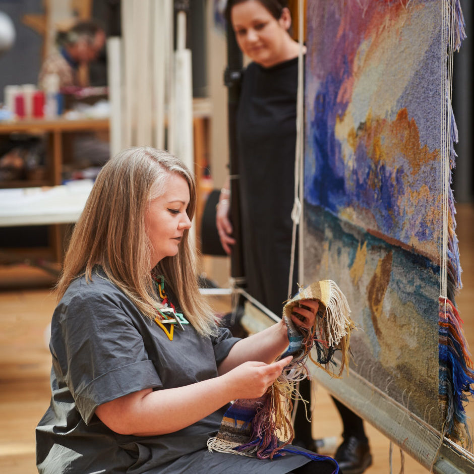 """Dovecot Studios, Edinburgh, February 2021. """"The Art of Being An Apprentice"""". Dovecot Apprentice Elaine Wilson (foreground) with her JMW Turner Tapestry. Pic free for first use relating to Dovecot Studios. Also pictured is Dovecot Studio Manager Naomi Robertson. For press information please contact Susan McAteer, Marketing and Sales Manager, Dovecot Studios susanmcateer@dovecotstudios.com +44 (0) 131 550 3660 © Malcolm Cochrane Photography  +44 (0)7971 835 065  mail@malcolmcochrane.co.uk  No syndication  No reproduction without permission"""